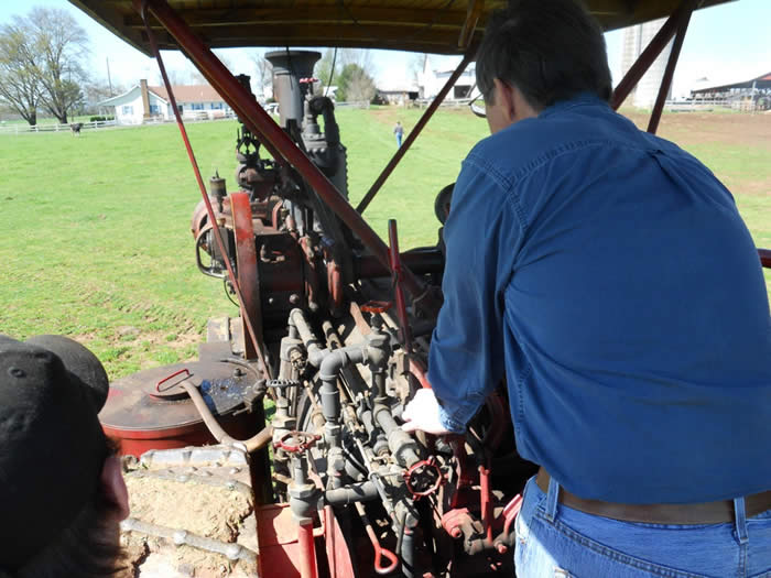 Students are given an opportunity to drive the traction engines in the pasture.